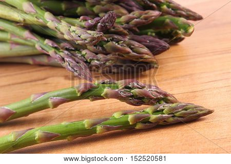 Bunch of fresh green asparagus on wooden surface concept of healthy food nutrition and strengthening immunity