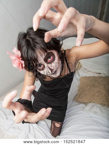 Young woman with zombie makeup for Halloween