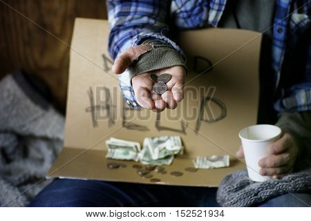 homeless man with a sign asking for money