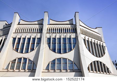 Grodno, Belarus - September 30, 2016: Facade of the Drama Theater in Grodno monument of Soviet architecture with large semicircular windows and pillars.