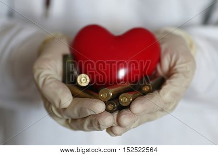 heart care and sleeve in doctor hand concept of help