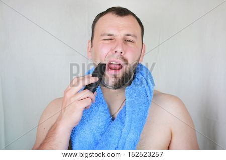 portrait of a man with a beard who needs a shave and a trim beard