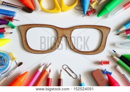 stationery on colored background set of pencils and various devices