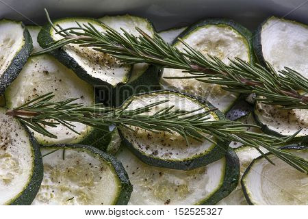 Stewed sliced zucchini with rosemary and pepper in the bowl