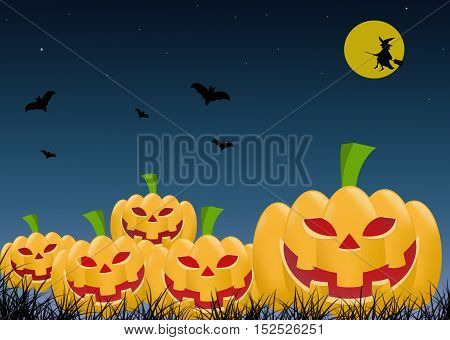 Several orange scary Halloween pumpkin with red eyes closeup with the bats and night sky with a witch in the background