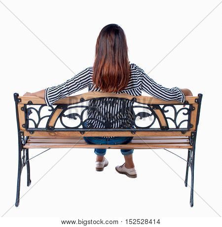 Back view of a woman sitting on a bench.  girl  watching. Rear view people collection.  backside view of person.  Isolated over white background. Brunette sat with his hands on the back