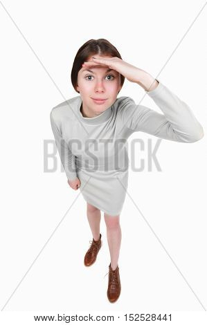 Funny portrait of a woman gazing into the frame. Wide-angle. Isolated over white background. A girl in a short white dress looks in the frame.