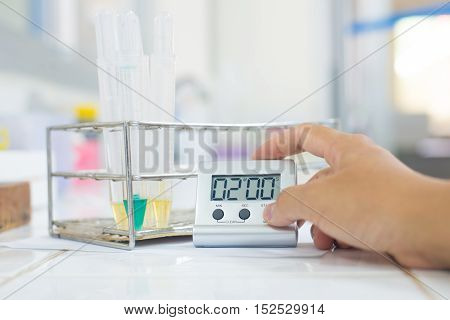 scientist with equipment and science experiments Laboratory glassware containing chemical liquid
