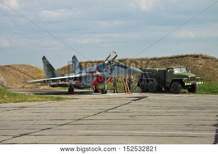 Vasilkov Ukraine - August 3 2012: Ukrainian Air Force Mig-29 fighter plane is being prepared for a training flight with its weapons attached