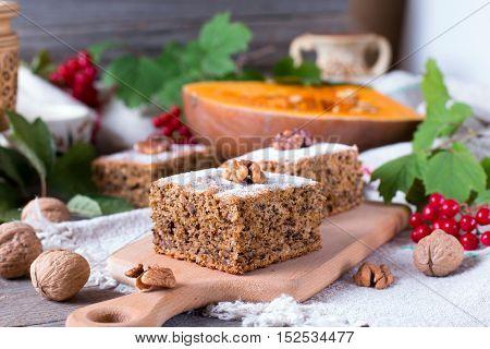 A piece of pumpkin pie on a wooden background