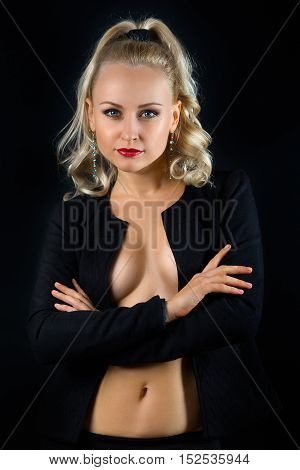Portrait of beautiful topless blonde woman in the black jacket with crossed hands on the black background. Makeup product photo.