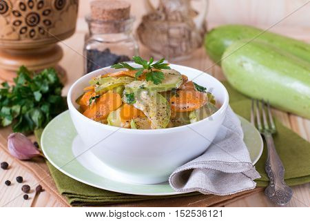Vegetable stew. Zucchini and carrots in a bowl