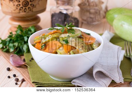 Vegetarian ragout of summer vegetables on a wooden background