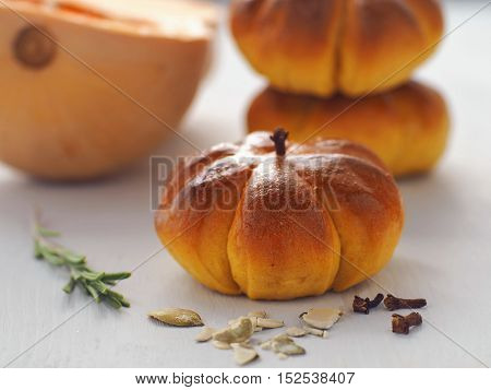 Pumpkin buns. Halloween pastry in the shape of pumpkin. Horizontal. Selective focus on the front.