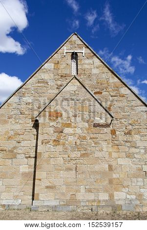 The back wall of a little historic church in Richmond town (Tasmania).
