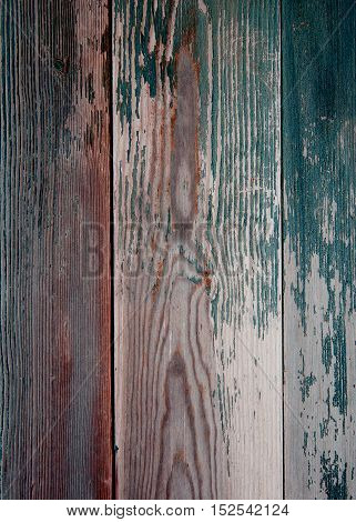 Background of Brown and Dark Green Peeling Old Wooden Board closeup