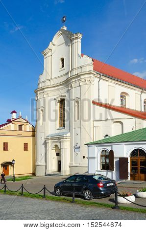 MINSK BELARUS - OCTOBER 1 2016: Unidentified man goes near Catholic Church of St. Joseph (now - Belorussian State Archive-Museum of Literature and Art) Minsk Belarus