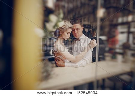 a wonderful couple celebrating in a cafe on her wedding day