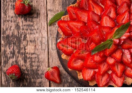 Tart With Strawberries And Whipped Cream On Wooden Background
