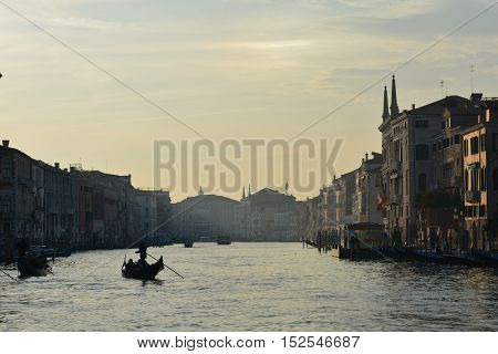 Romantic view of sunset with the gondola.