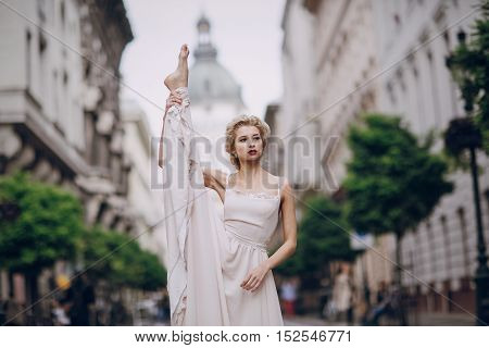 gymnastics the bride posing on the street in Budapest