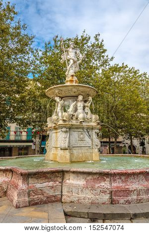 CARCASSONNE,FRANCE - AUGUST 29,2016 - Fountain of Neptune in Carcassone . Carcassonne is a fortified French town in the Aude department.