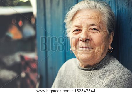 Happy old senior woman smiling outdoor portrait