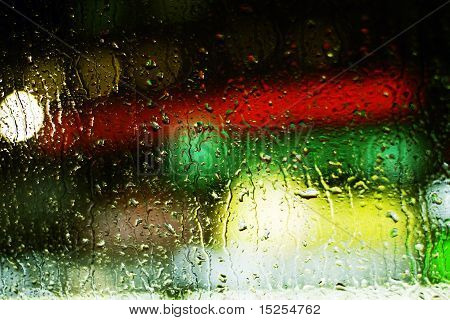 traffic lights in the night and rain