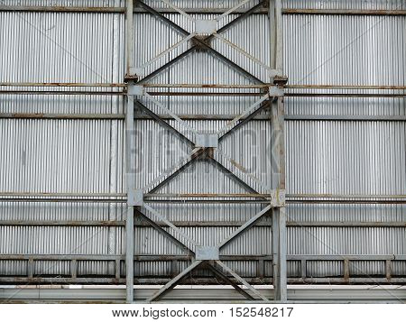a large fence made of metal frame and sheet.