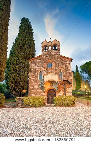 Gorizia, the small church of Santo Spirito and the castle at sunset. Friuli Venezia Giulia, Italy.