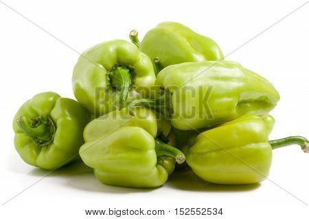 a bunch of green peppers isolated on white background.