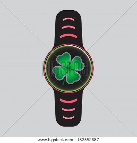 Black smart watch with green clover decor.