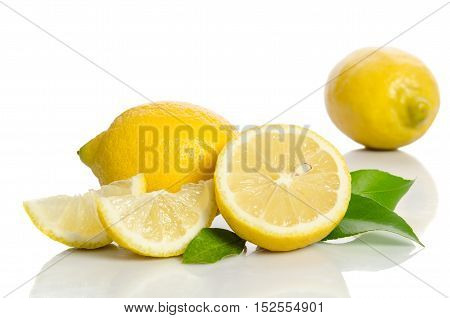 Two Lemons And Half With Leaves  Isolated On White Background