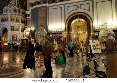 MOSCOW, RUSSIA - NOVEMBER 27, 2015: Professional painters help talented children from large families draw their guardian angel during annual action