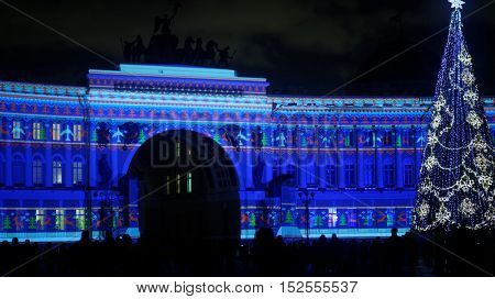 ST. PETERSBURG, RUSSIA - DECEMBER 23, 2015: People watching the New Year lighting show at the General Staff building. The show is sponsored by Aeroflot, the largest Russian airlines