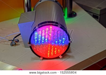 Large Colored Led Spotlight On The Table.