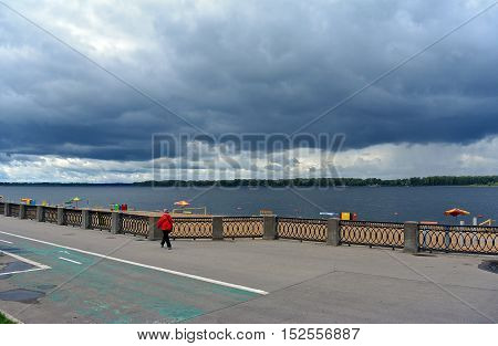 View on the Volga quay of the Samara city in anticipation of thunderstorm. City embankment, beautiful sky with cumulus clouds before rain at cloudy autumn day