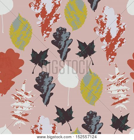 Floral autumn seamless pattern with grunge tree leaves on pastel pink. Maple, Elm, Oak, Aspen textured leaves background. Vector illustration.