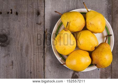 Juicy pears, fresh ripe organic pears on rustic wooden table, natural background, organic pears, diet food.