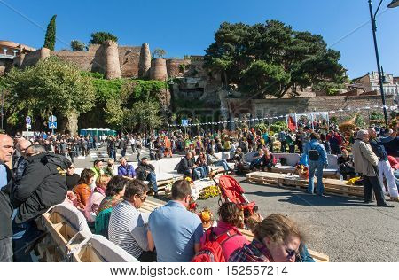 TBILISI, GEORGIA - OCT 16, 2016: Crowd of people with families relaxing on area of popular city festival Tbilisoba on October 16, 2016. Tbilisoba is traditional festival in capital of Georgia from 1979