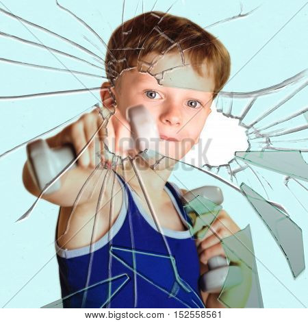 Boy athlete with dumbbells broken glass hand
