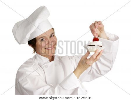 Chef Putting Strawberry On Top