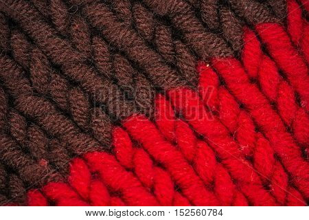Macro flat view of knitted surface in brown and red