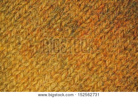 Macro flat view of knitted surface in autumn yellow