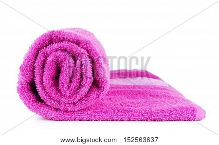 Rolled up pink towel isolated on white