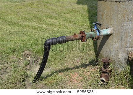 The Pipe From The Water Tower. Steel Or Plastic Pipe, Valve And Knee On The Tube