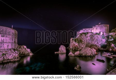 View of Dubrovnik - Fortresses Lovrijenac (right side) and Bokar at night.