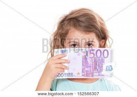 Little girl holding 500 euro. All on white background.