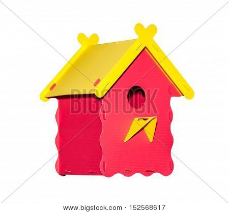 Plastic birdhouse of red color isolated on white background