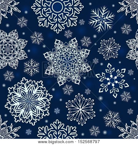 Abstract seamless Christmas snowflake pattern. Tileable blue and white ornamental snowflakes background.